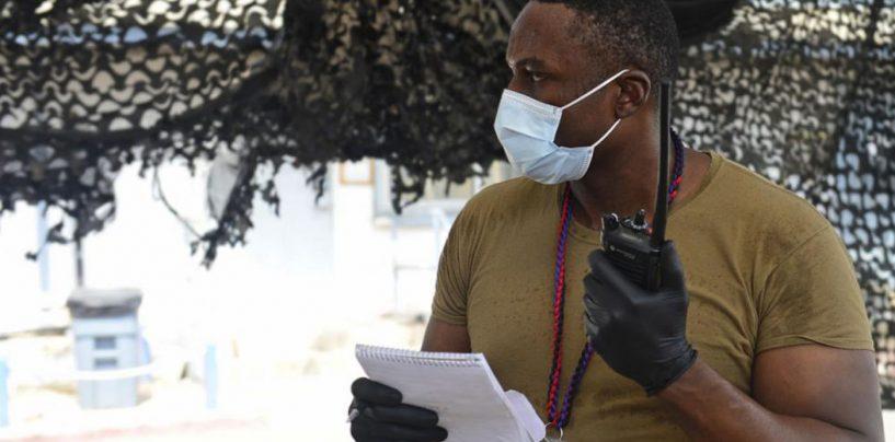 District of Columbia Native Mans a Radio During a Simulated Mass Casualty Exercise