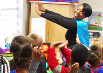Woman Educator Who Transforms Herself into a Superhero in the Classroom